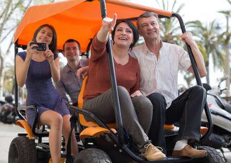 european family of tourists enjoy a walk on the bike carriage