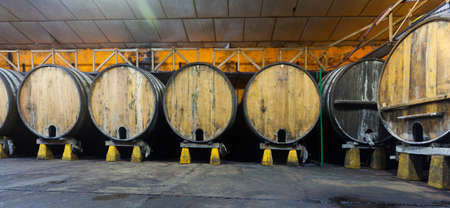 large wooden barrels in a traditional cider factory Stockfoto