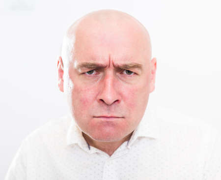 portrait of bald adult mature man with emotions on white background. High quality photo Zdjęcie Seryjne