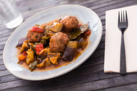 steamed meatballs with stewed vegetables with haze on plate