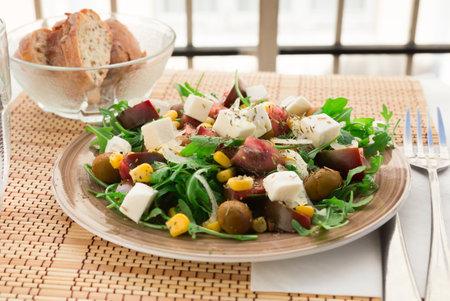 appetizing fresh vegetarian healthy vegetable salad with arugula and chees Standard-Bild