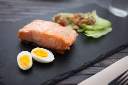 steamed salmon fillet with guacamole homemade and quail egg