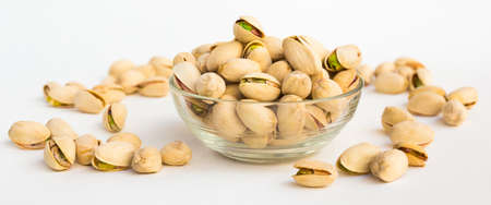 roasted salted pistachios on white background