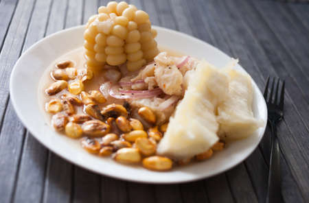 Peruvian traditional dish. white fish ceviche with yuka and corn
