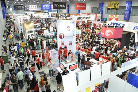 conventions: KUALA LUMPUR, MALAYSIA - AUGUST 8: Massive crowd in Pikom PC Fair 2010 on August 8, 2010 at Kuala Lumpur Convention Center, Kuala Lumpur. Editorial