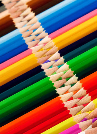 Many colorful pencils arranged in a patterned way