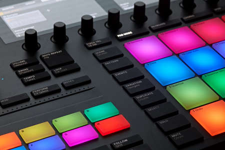 Close up view of professional studio sound recording device with colorful buttons and knobs