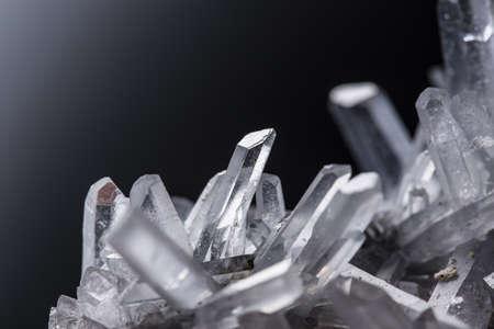 Pure Quartz Crystal cluster on black background.