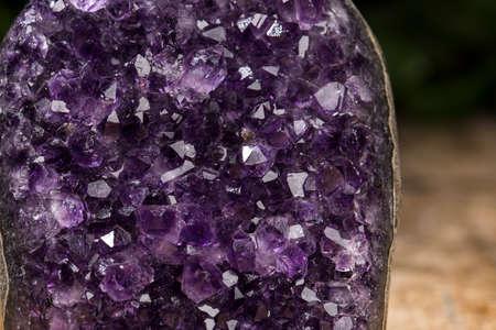 Amethyst geode on black background. Beautiful natural crystals gemstone.