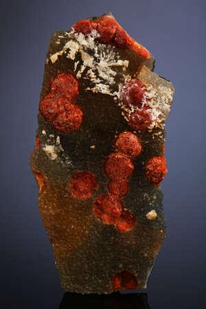Quartz crystals coated with iridescent limonite . Stock Photo