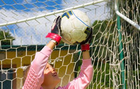 goalkeeper: Goalkeeper child who saved the ball