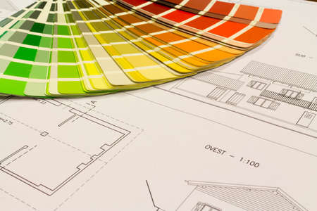 color chart: An office desk with the project papers and color chart