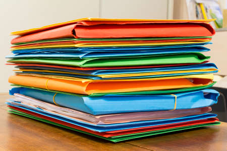 archival: Stack of folders with archival documents in the office