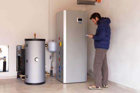 metering: plumber at work making the consumption metering