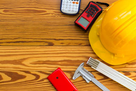 architect tools: Safety helmet and tools to architect on wooden background
