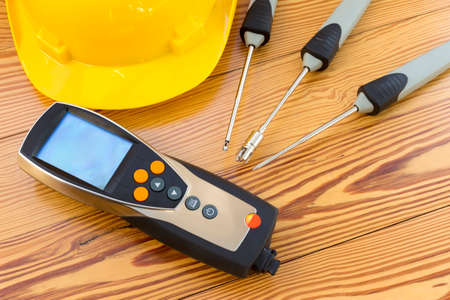 electronic background: Electronic instrument for measuring of temperature probes on wood background