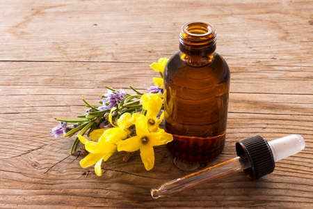 essence: close-up of essence of forsythia on wooden table