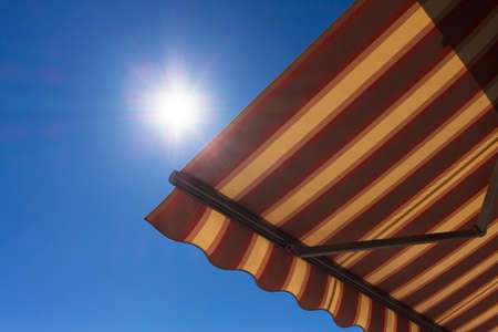 the sun and shade: Sun shade  with blue sky in the background