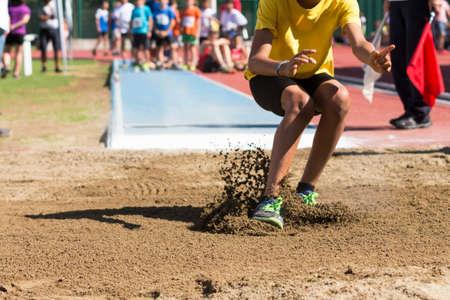 Athletics: child performs the long jump Standard-Bild