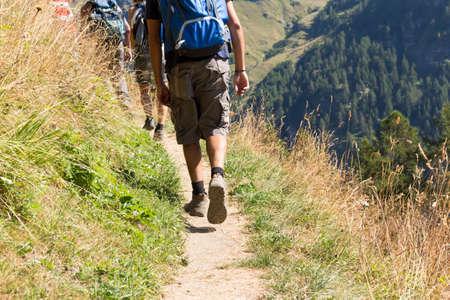 people walking on a mountain trail