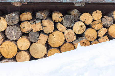 heap of snow: close-up of stack of firewood covered by snow Stock Photo