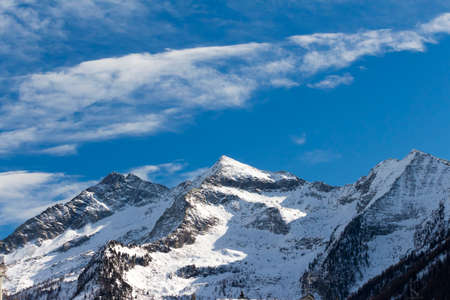 pila: Alpine landscape with mountains, trees and snow