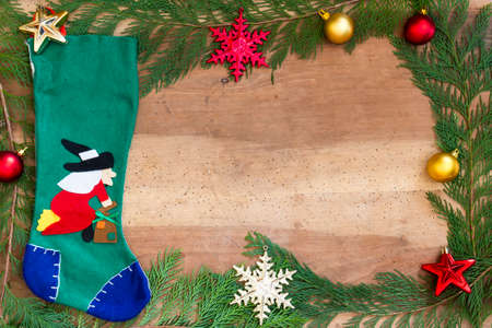 Stocking Befana And Christmas Decorations On Wooden Background