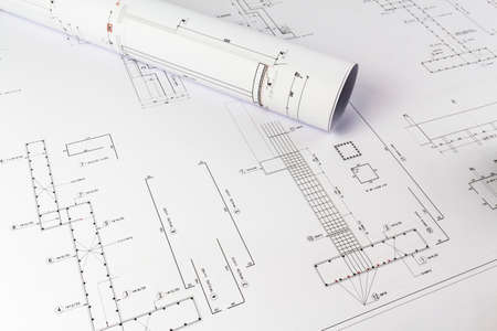 Building design: Office desk with project drawings