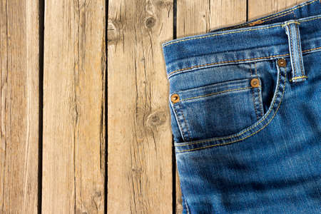 Close up of jeans pants on wooden background Stockfoto