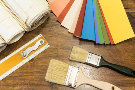 color chart and brush on a wooden background Stockfoto