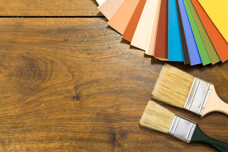 Color chart and brush on a wooden background