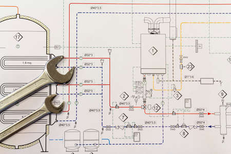 Maintenance and service: Wrench and project drawings with plumbing system Standard-Bild
