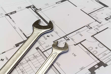 Maintenance and service: Wrench and project drawings with residential building
