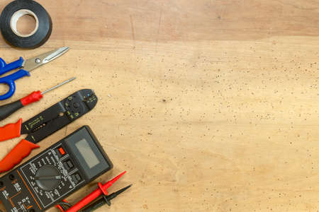 Electrician tools, components and instruments  on a wooden background Stockfoto
