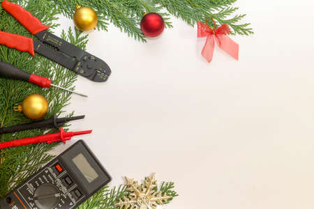 Electrician tools and instruments  and Christmas decorations on white background Stockfoto