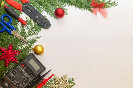 Electrician tools and instruments  and Christmas decorations on white background Stok Fotoğraf