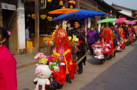 red head: Ancient traditional Chinese procession red head truck Editorial