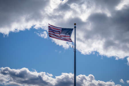 USA flag against clouds Фото со стока