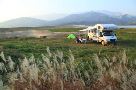 People and recreational vehicle at the outdoor