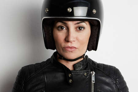 Close-up portrait of attractive biker girl wearing helmet. Horizontal.