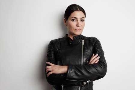 Portrait of attractive biker girl wearing leather jacket. Imagens