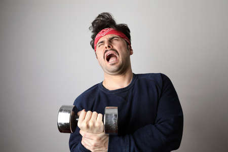 Young hipster man with moustache doing exercise.