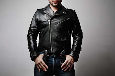 Mock-up of man wearing leather jacket stands frontal in the studio. Horizontal. Stockfoto