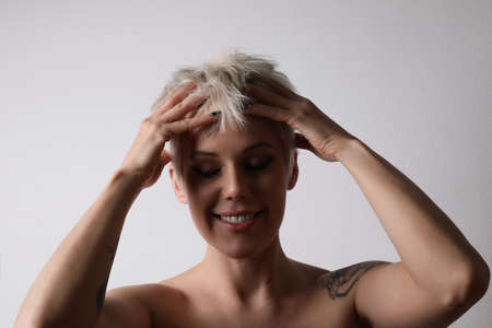 Beautiful woman massaging her head. Scalp massage. Lymphatic massage. Isolated.