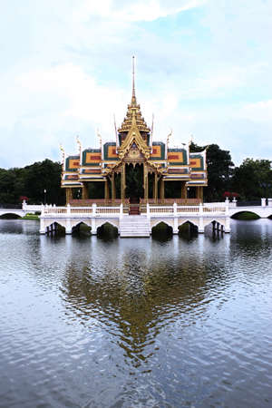 commanded: A Thai design pavilion in the middle of the pond was built in the reign of King Rama V  Orginally built of wood throughout, King Rama VI commanded to change the floor and pillars to be reinforced concrete