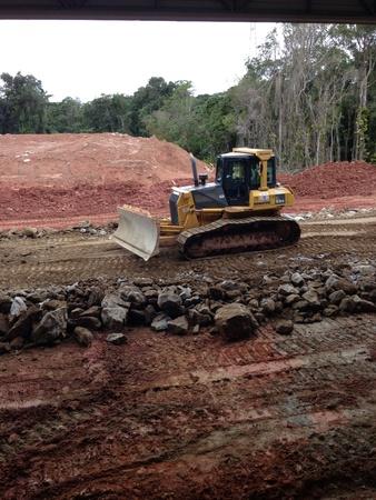 constrution: Bulldozer at a constrution site working