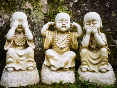 Three wise little Buddhas statues Stock Photo