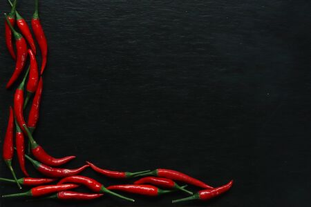 Photography of red hot peppers on slate background for restaurant menu Banque d'images