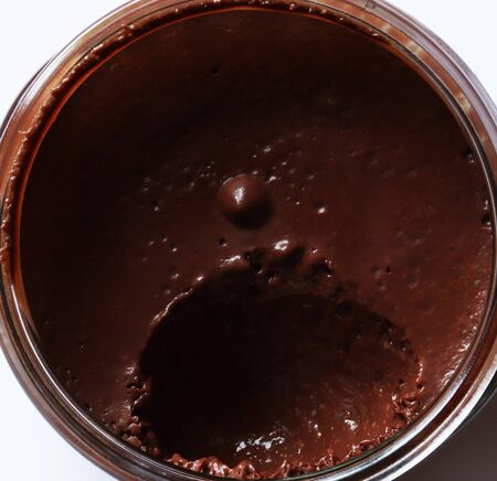Photography of eaten chocolate mousse in glass jar pattern for food background or illustations