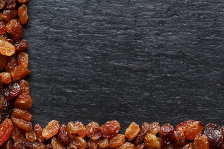 Photography of raisins on slate background for restaurant menu, label or sign